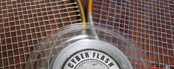 Deux raquettes de tennis et un cordage Top Spin